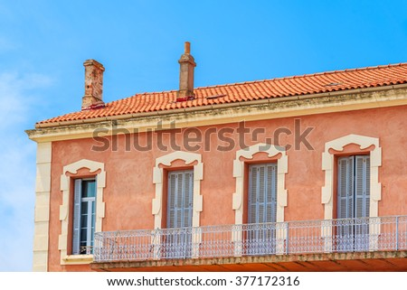 Facade of typical French house in Calvi port, Corsica island, France - stock photo