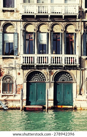 Facade of typical medieval house on Grand canal, Venice, Italy. Vintage toned image  - stock photo