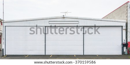 facade of white small  warehouse. - stock photo