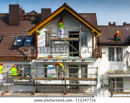 Facade thermal insulation and painting works - stock photo