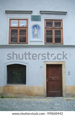 Facade wall of tenement house with a figure of a saint