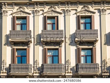 Facade with balconies in Barcelona - stock photo