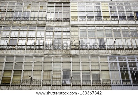 Facade with old windows, detail of some old windows in Spain, architectural detail - stock photo