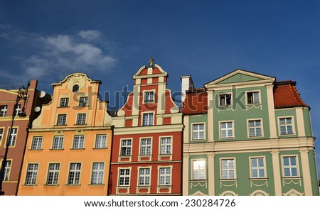 Facades of colour buildings on the old square in Wroclaw, Poland - stock photo