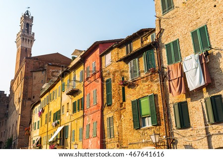 facades of old buildings in Siena, Italy