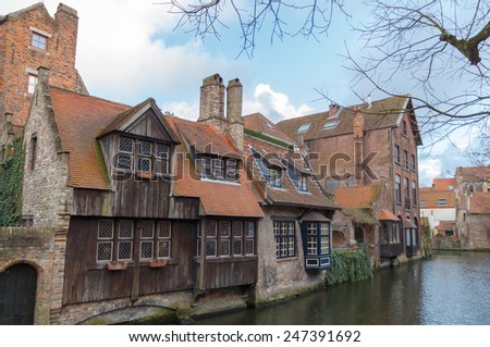 Facades of old medieval buildings on the canals of Bruges.