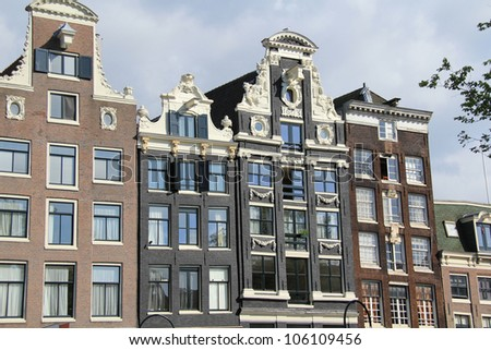 Facades of the typical houses in Amsterdam , Netherlands ( Holland ) - stock photo