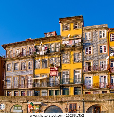 facadesof thin typical houses in old town, Porto, Portugal - stock photo