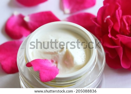 Face and body cream with rose - stock photo