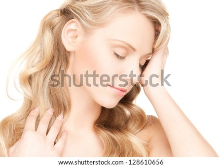 face and hands of worried woman with long hair