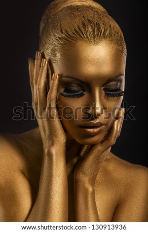 Face Art. Fantastic Gold Make Up. Stylized Colored Woman's Body. Surrealism - stock photo