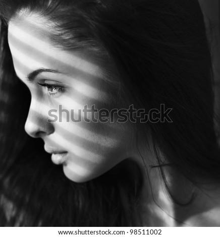 face beautiful brunette close-up - stock photo