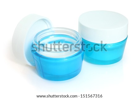 Face cream boxes on a white background - stock photo