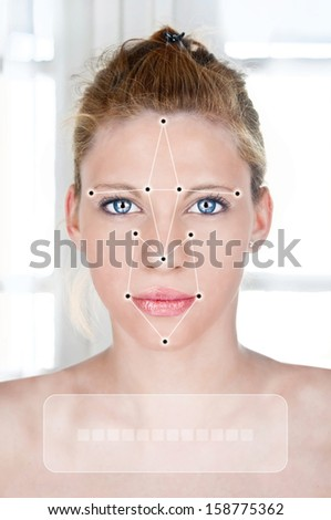 Face detection software recognizing a face of beautiful young woman - stock photo