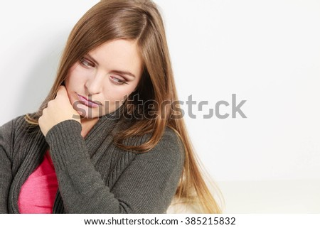Face emotional expression of sadness. Unhappy worried thinking woman, depressed girl deep in thought. Female contemplating life. - stock photo