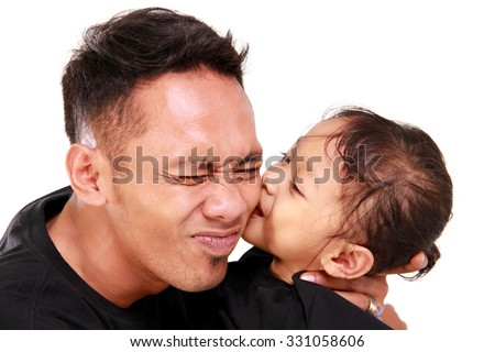 Face expression of young Asian father kissed by her cute little daughter, close up portrait, isolated on white background - stock photo