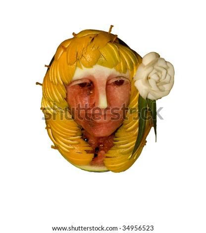 Face fruit carving - stock photo