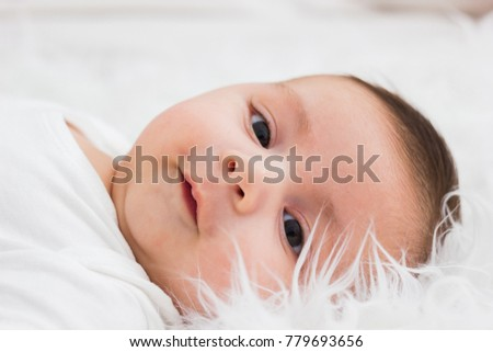 face in close up of latin baby lying in his crib
