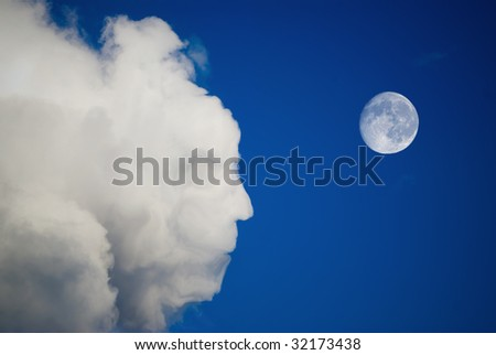 face in clouds and moon