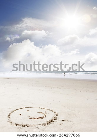 Face made on sand at beach - stock photo