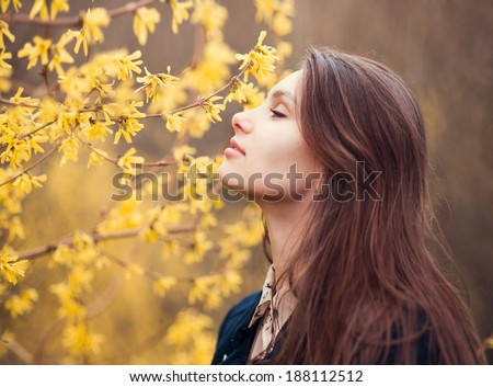 face of a beautiful girl in spring - stock photo