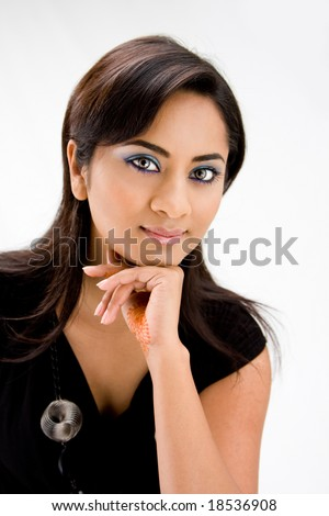 Face of a beautiful Hindi woman with subtle blue eye makeup and strong eyes, isolated