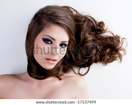 Face of a beautiful  woman with  long ringlets healthy hairs - stock photo