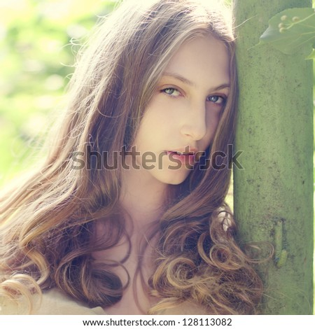 face of a beautiful young girl outdoors in summer