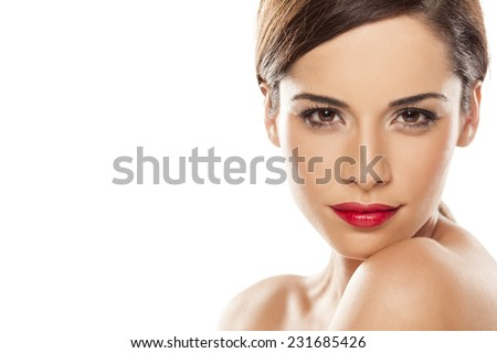 face of a beautiful young smiling woman on white - stock photo