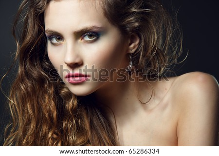 Face of a beautiful young woman with bright makeup - stock photo