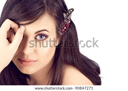 face of a beautiful young woman with brown long hair and pink eyeshadows and lipstick. - stock photo