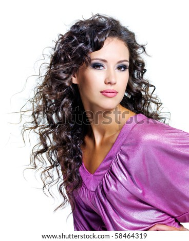 Face of  a beautiful young woman with brown long ringlets hairs and dark fashion make up. Isolated on white - stock photo