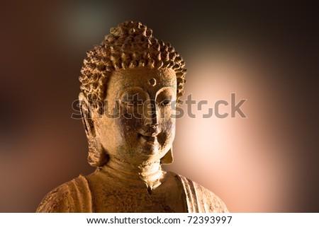 Face of a buddha figure - stock photo