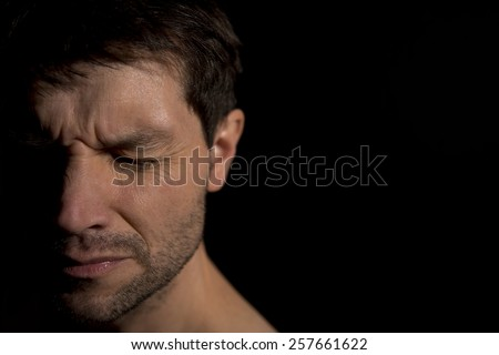Face of a distraught man - stock photo