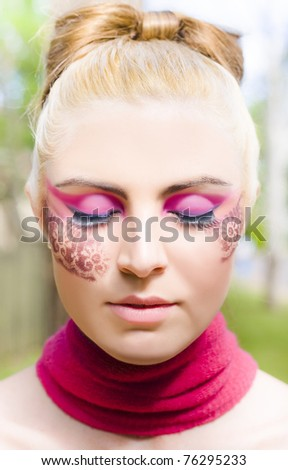Face Of A Doll In Sleep Wearing Creative Lace Design Cosmetics And Makeup In A Beautiful Portrait Representing Dreams That Inspire Thoughts And Imagination - stock photo