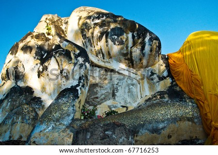 Face of a reclining buddha statue - stock photo