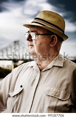 Face Of A Retired Senior Man Wearing Glasses And Hat Looking To The Future For A Vision Of Hope And Opportunity - stock photo