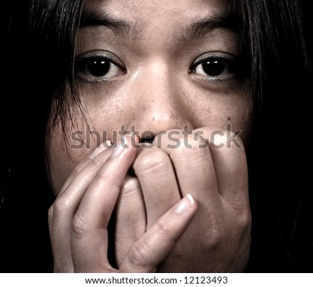 Face of a scared woman - stock photo
