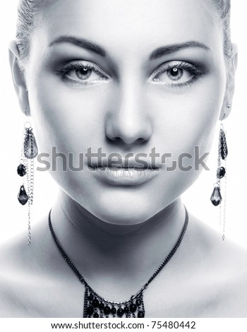 Face of a sexy beautiful young woman with clean skin on a white background - stock photo