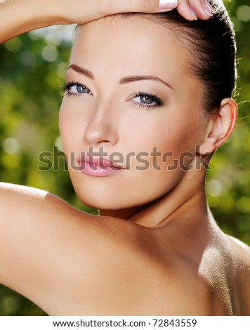 Face of a sexy beauty woman with clean skin - outdoors - stock photo