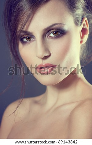 Face of a sexy young brunette woman with perfect skin - stock photo