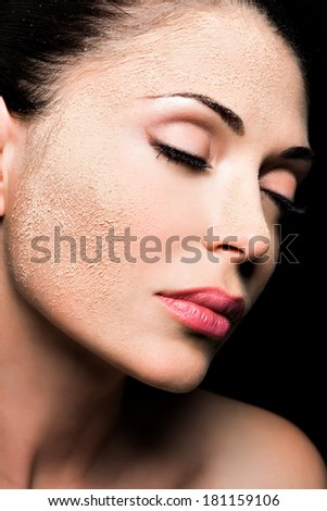 Face of a woman with cosmetic powder on skin - isolated on white