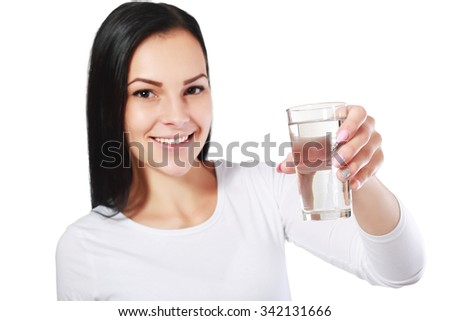 face of a young healthy woman and a glass of clean water Focus on glass - stock photo