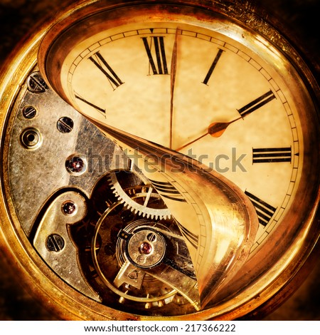 Face of an antique pocket watch being peeled back to reveal the cogs beneath