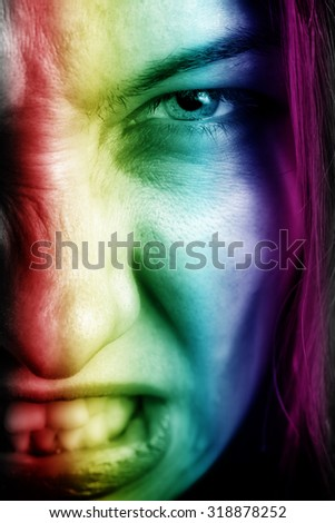 Face of angry woman with mad crazy expression - stock photo