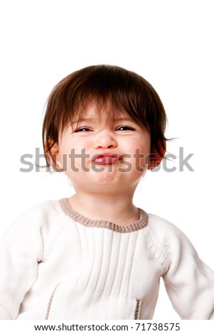 Face of baby toddler infant child with funny expression and mischievous rascal look, isolated. - stock photo