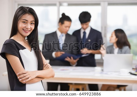 Face of beautiful asian woman on the background of business people.
