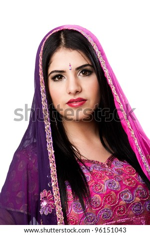 Face of beautiful Bengali Indian Hindu woman in colorful dress and veil, isolated - stock photo