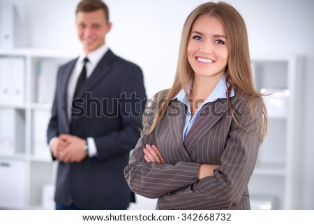 Face of beautiful business woman on the background of business people - stock photo