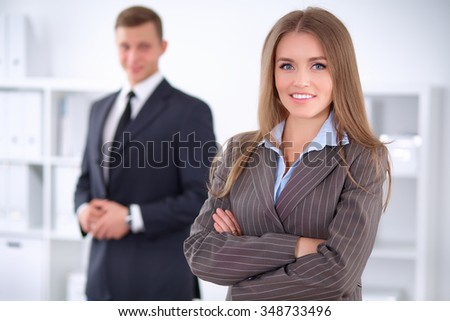 Face of beautiful business woman on the background of business people